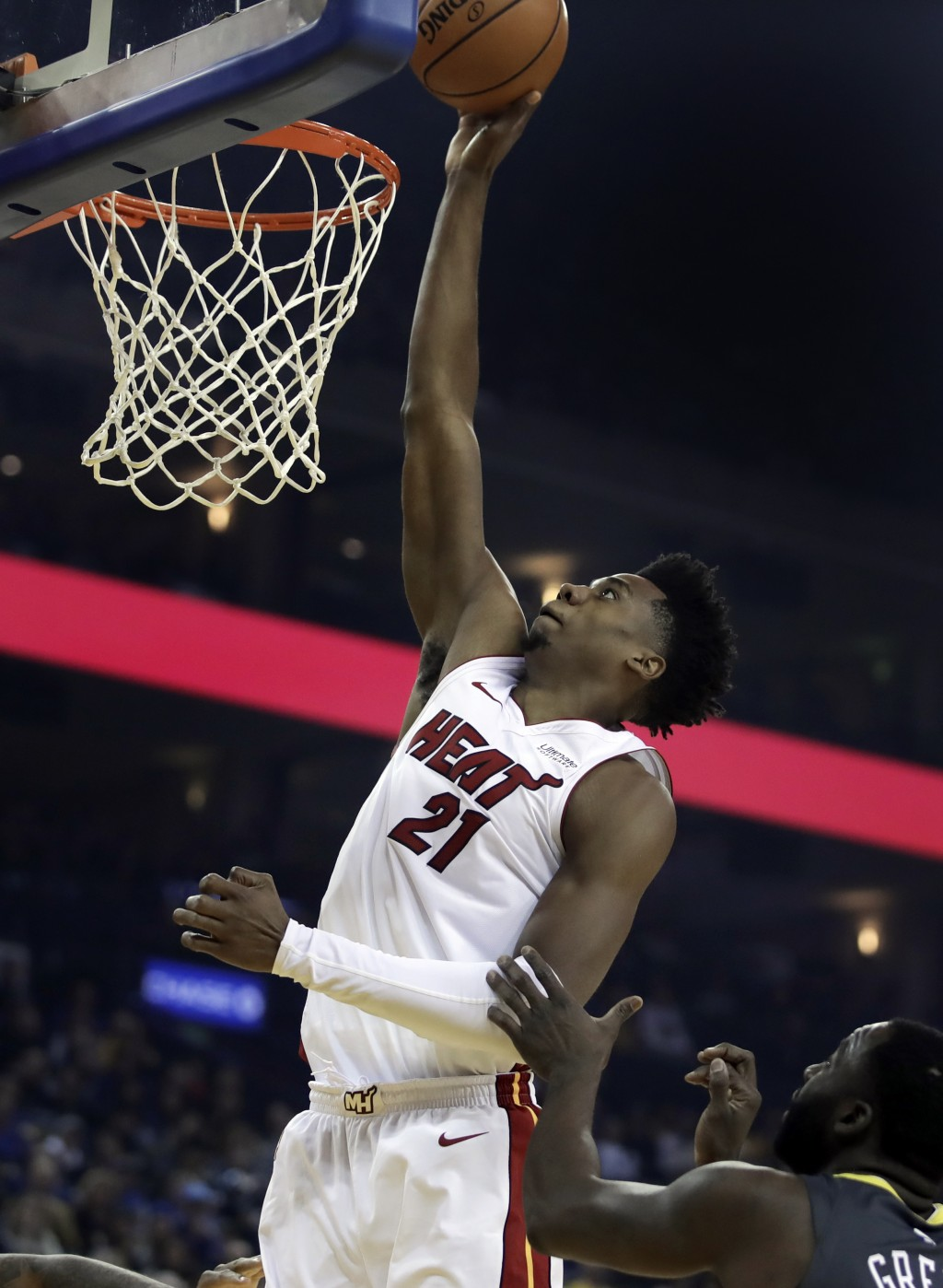Miami Heat center Hassan Whiteside (21) shoots over Golden State Warriors' Draymond Green during the first half of an NBA basketball game day, Feb. 10...