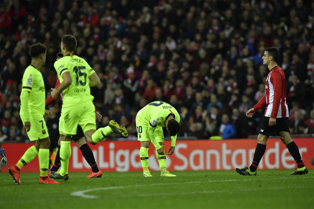 FC Barcelona's Lionel Messi, center, reacts during the Spanish La Liga soccer match between Athletic Bilbao and FC Barcelona at San Mames stadium, in