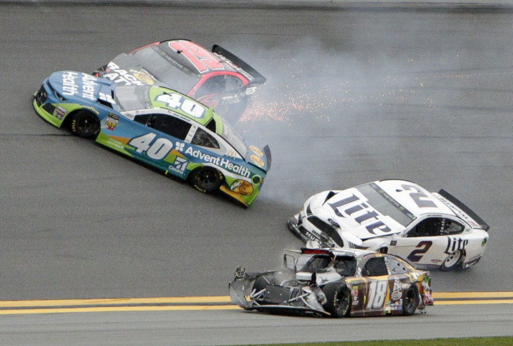 Jamie McMurray (40), Martin Truex Jr. (19), Brad Keselowski (2) and Kyle Busch (18) get caught up in a multi-car crash during the NASCAR Clash auto ra...