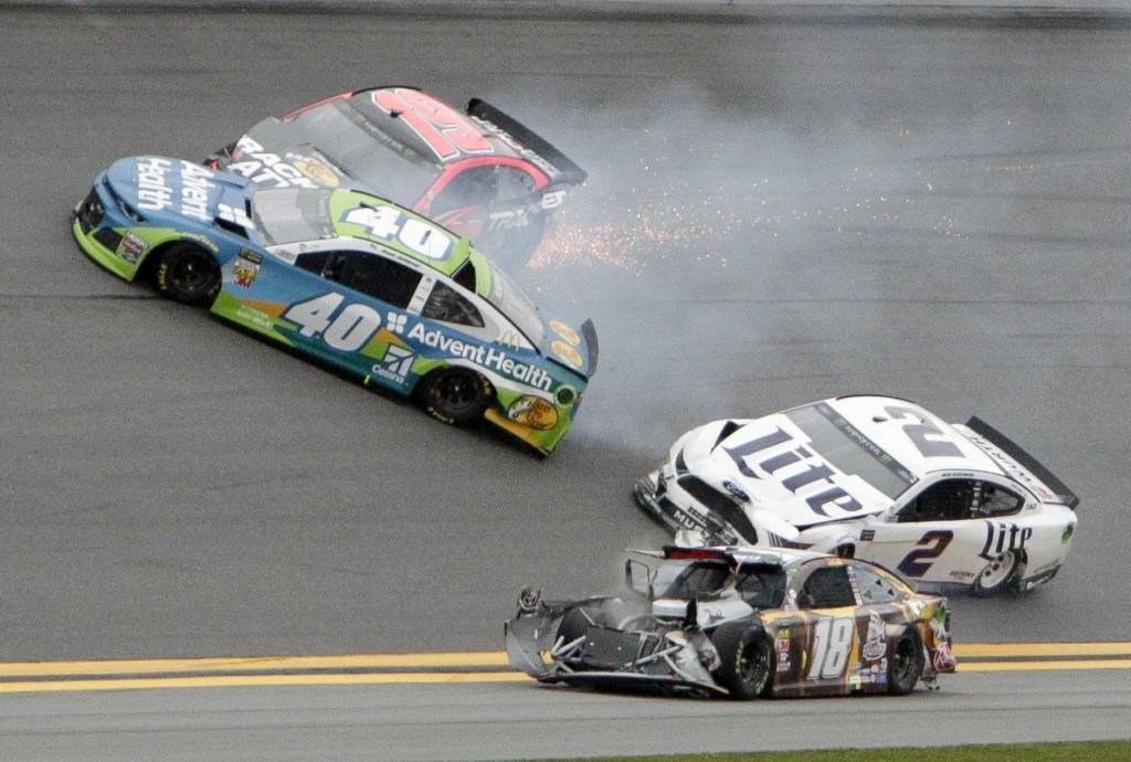 Jamie McMurray (40), Martin Truex Jr. (19), Brad Keselowski (2) and Kyle Busch (18) get caught up in a multi-car crash during the NASCAR Clash auto ra
