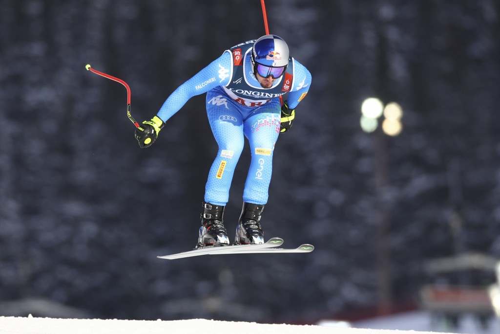 Italy's Dominik Paris speeds down the course during the downhill portion of the men's combined, at the alpine ski World Championships in Are, Sweden,