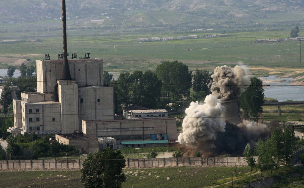 FILE - In this June 27, 2008 file photo released by China's Xinhua News Agency, the cooling tower of the Yongbyon nuclear complex is demolished in Yon
