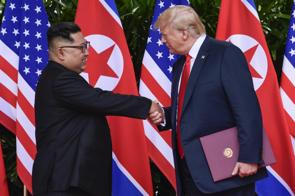 FILE - In this June 12, 2018, file photo, North Korea leader Kim Jong Un, left, and U.S. President Donald Trump shake hands at the conclusion of their