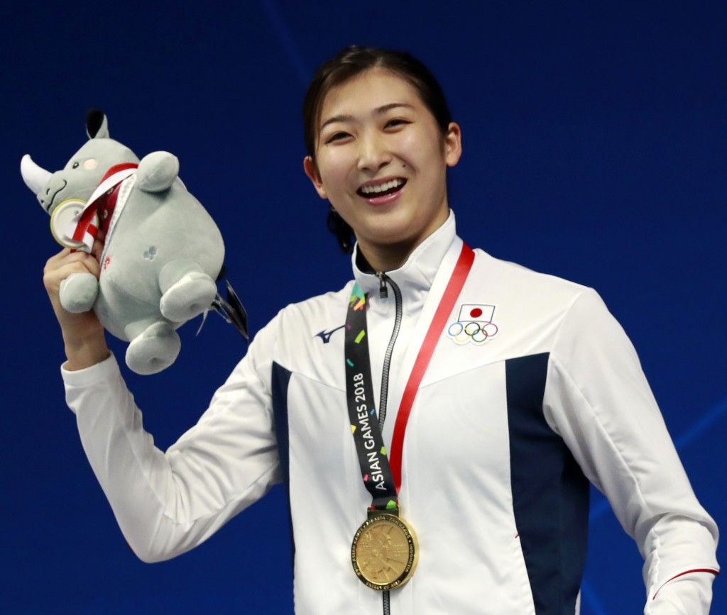 FILE - In this  Aug. 20, 2018, file photo, Japan's Rikako Ikee poses on the podium after winning the women's 100m freestyle final during the swimming ...