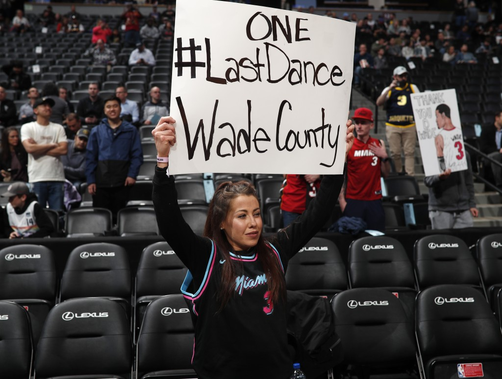 A Miami Heat fan holds up a sign for Heat guard Dwyane Wade in the first half of an NBA basketball game against the Denver Nuggets Monday, Feb. 11, 20...