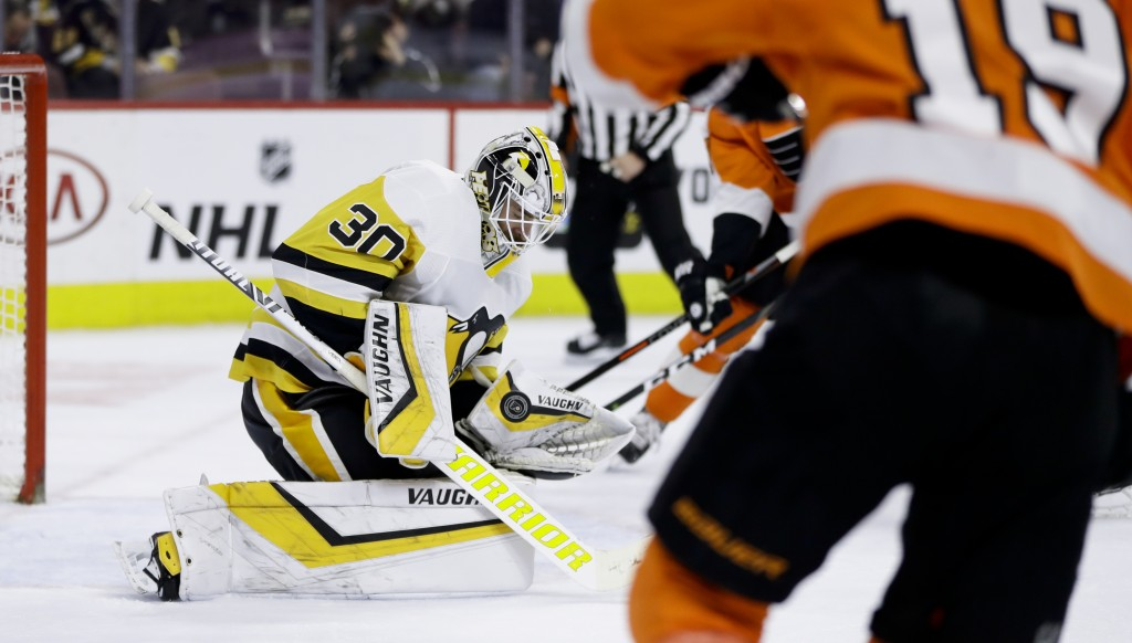 Pittsburgh Penguins' Matt Murray (30) blocks a shot during the second period of an NHL hockey game against the Philadelphia Flyers, Monday, Feb. 11, 2