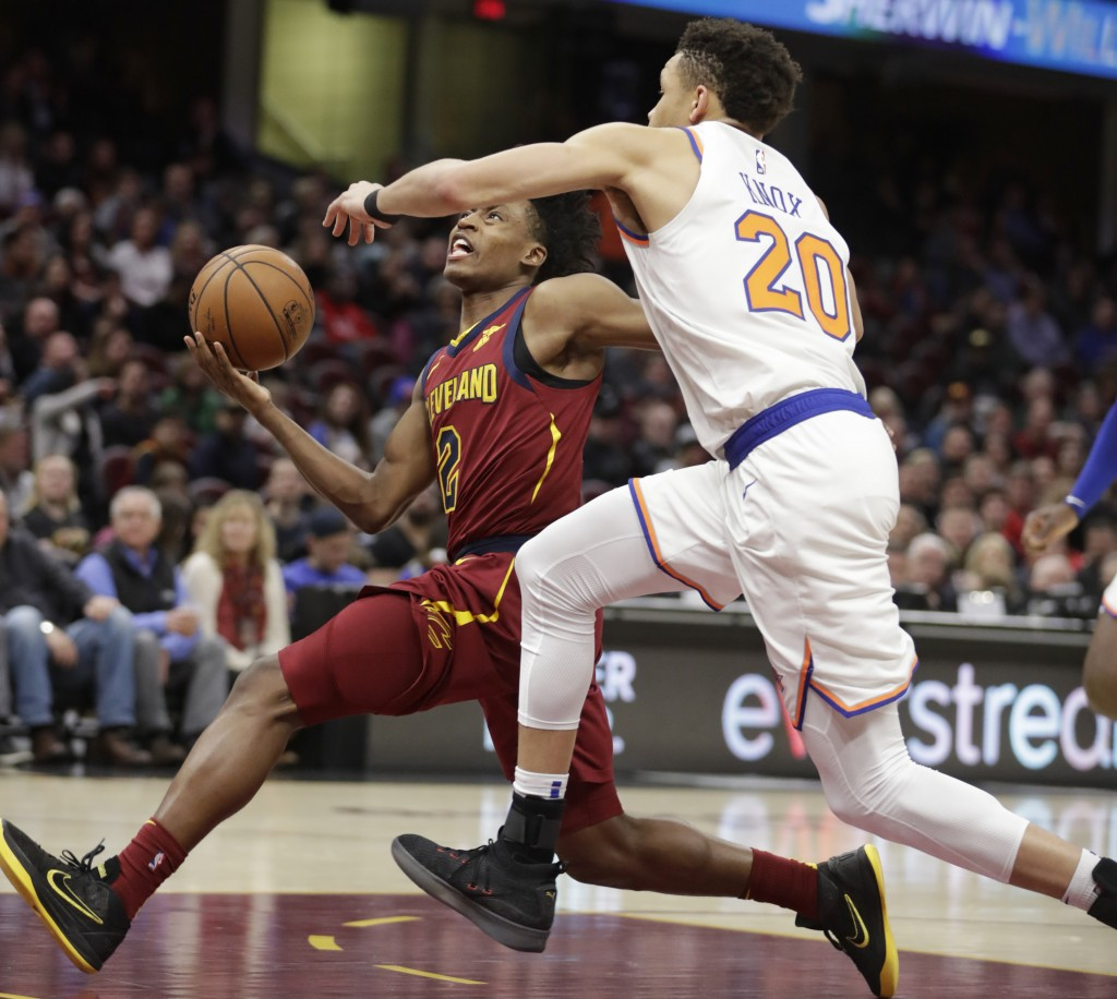 Cleveland Cavaliers' Collin Sexton (2) drives to the basket against New York Knicks' Kevin Knox (20) in the first half of an NBA basketball game, Mond...