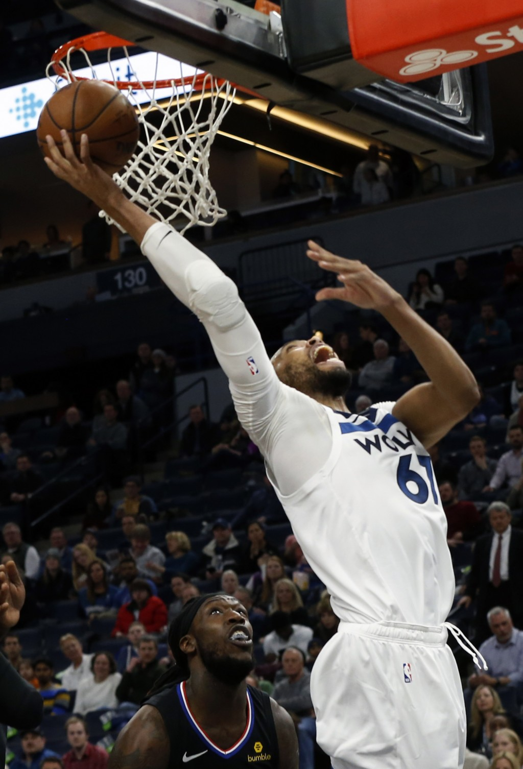Minnesota Timberwolves' Taj Gibson lays up a shot against the Los Angeles Clippers in the first half of an NBA basketball game Monday, Feb. 11, 2019, ...