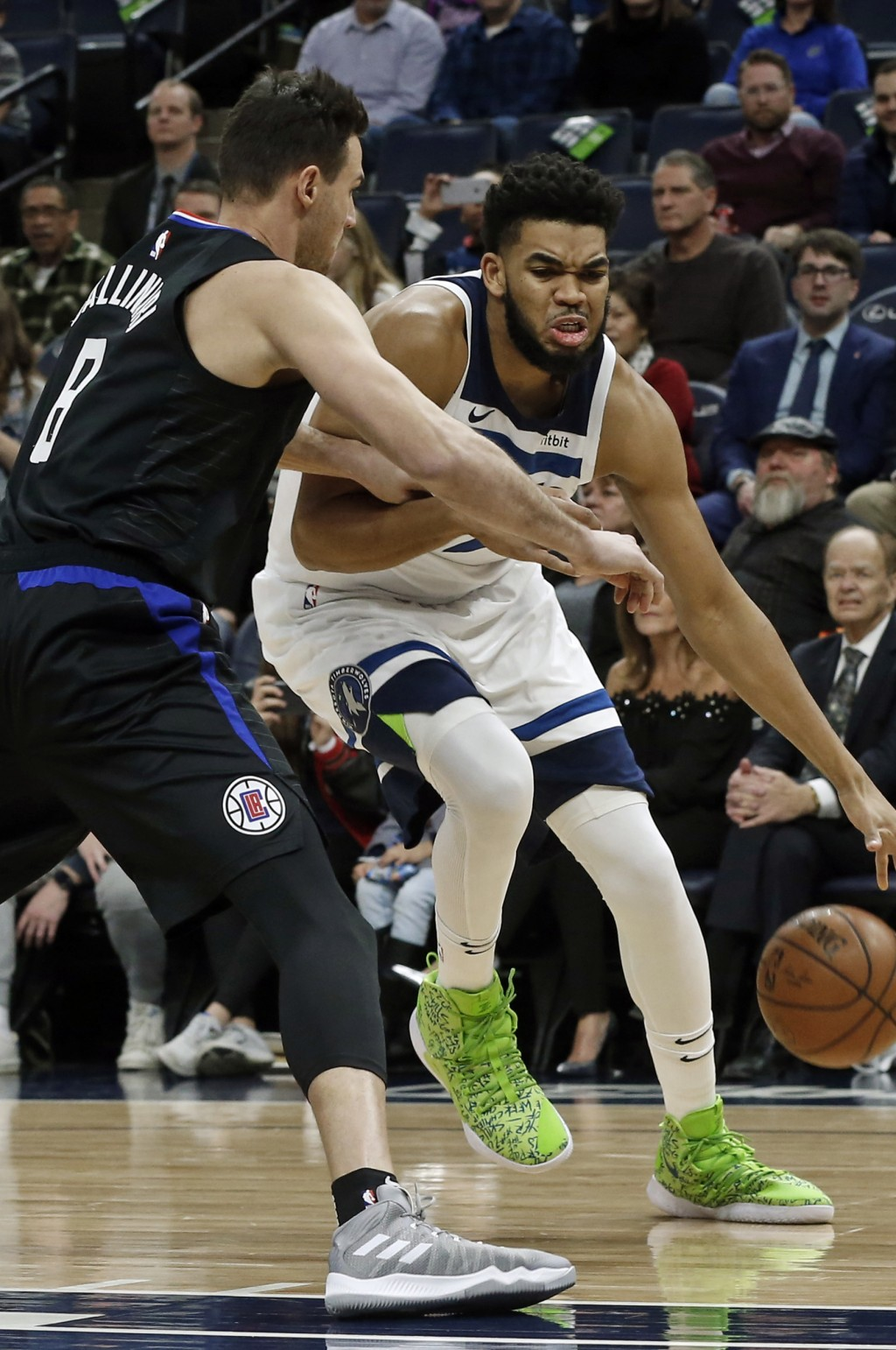 Minnesota Timberwolves' Karl-Anthony Towns, right, tries to work around Los Angeles Clippers' Danilo Gallinari in the first half of an NBA basketball ...