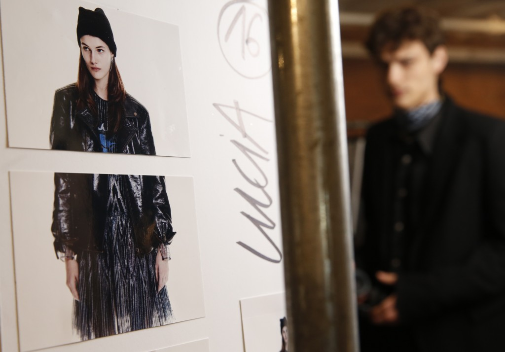 A model waits backstage before the Zadig & Voltaire fashion show is modeled during Fashion Week Monday, Feb. 11, 2019, in New York. (AP Photo/Kathy Wi...