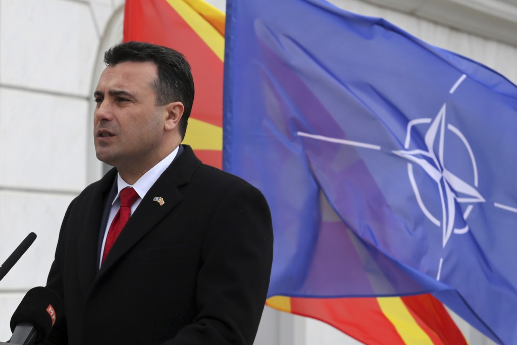 Macedonian Prime Minister Zoran Zaev delivers a speech in front of the NATO flag during a ceremony at the government building in Skopje, Tuesday, Feb....