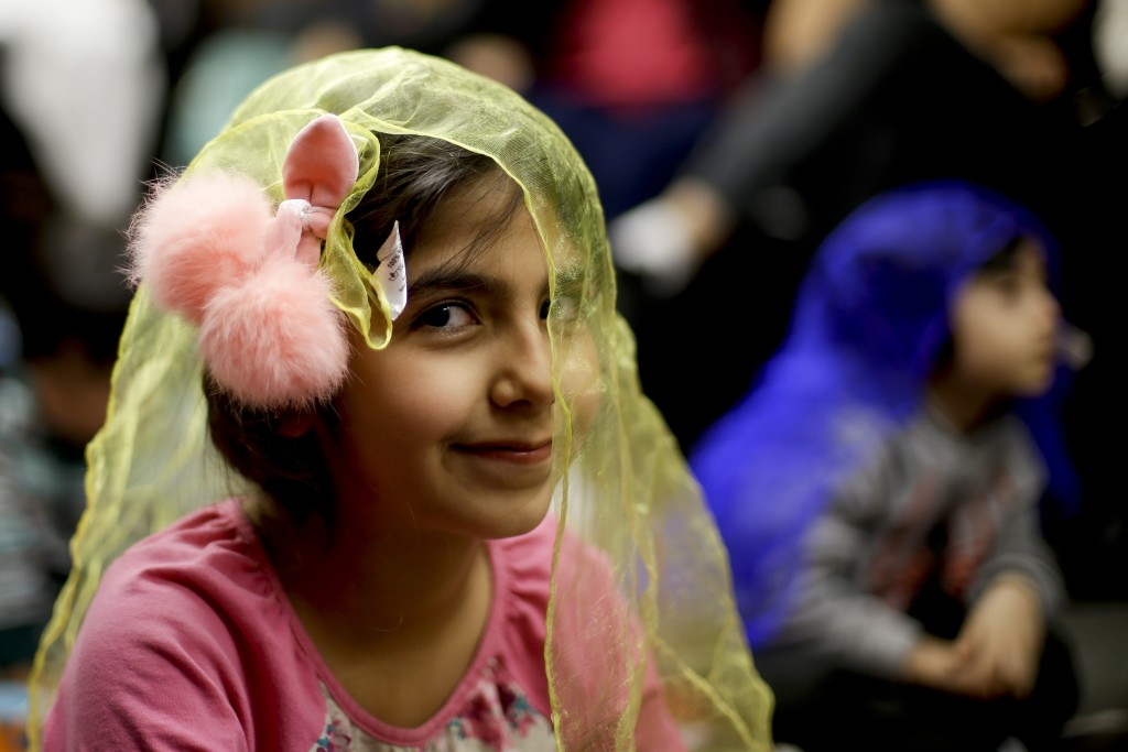 In this Wednesday, Jan. 23, 2019, photo, Melorin Issarezal 8, plays with a scarf during Persian story time at Irvine public library in Irvine, Calif.