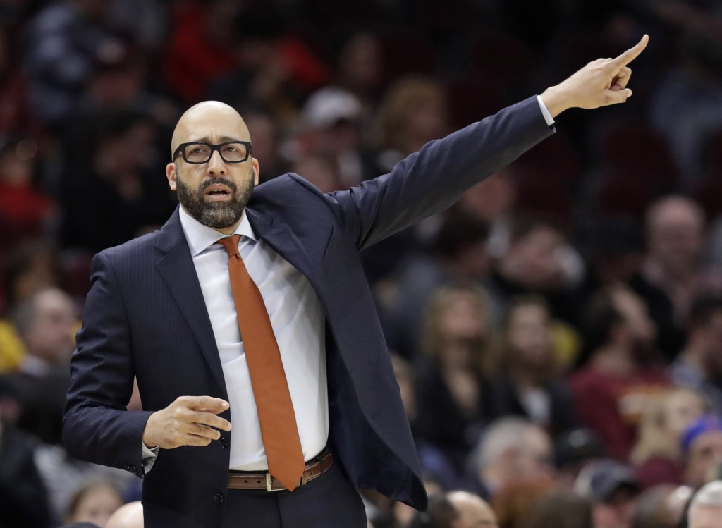 New York Knicks head coach David Fizdale gives instructions to players in the first half of an NBA basketball game against the Cleveland Cavaliers, Mo...