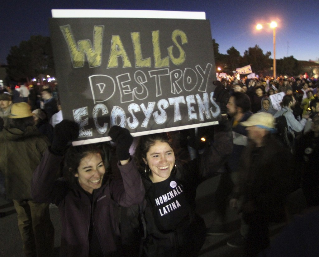 Isa Casillas, left, and Janelle Hernandez, of Las Cruces, N.M., take part in a march and rally outside the El Paso County Coliseum, where President Tr