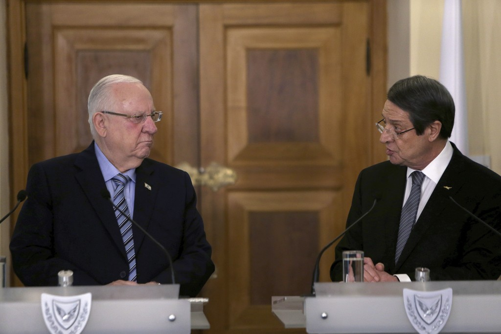 Cyprus' President Nicos Anastasiades, right, and Israel's President Reuven Rivlin talk to the media during a press conference after their meeting at t