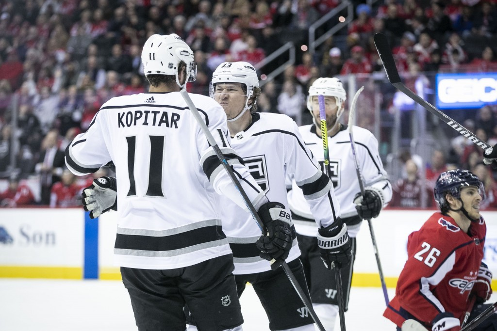 Los Angeles Kings right wing Tyler Toffoli (73) celebrates with center Anze Kopitar (11) after scoring a goal during the first period of an NHL hockey...