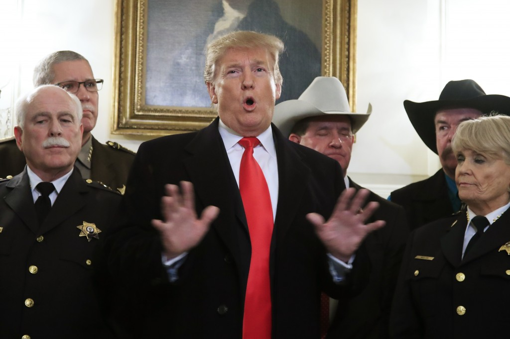 President Donald Trump speaks during a meeting with a group of sheriffs from around the country before leaving the White House in Washington, Monday, ...