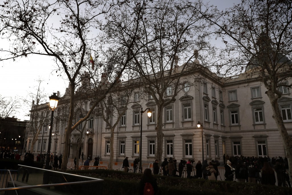 Journalists wait outside the Spanish Supreme Court in Madrid, Tuesday, Feb. 12, 2019. Spain is bracing for the nation's most sensitive trial in four d...