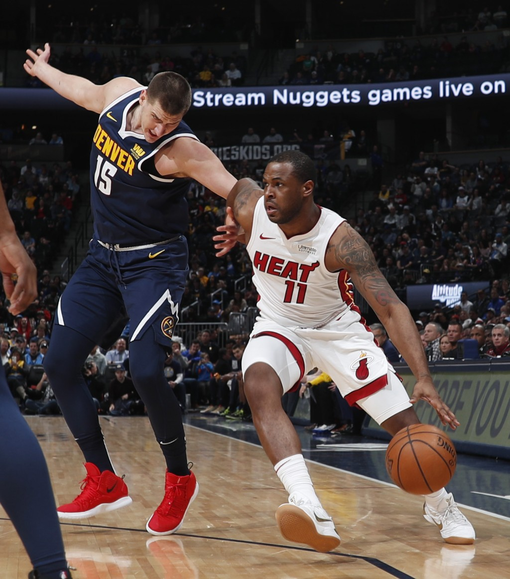Miami Heat guard Dion Waiters, right, drives past Denver Nuggets center Nikola Jokic in the first half of an NBA basketball game Monday, Feb. 11, 2019