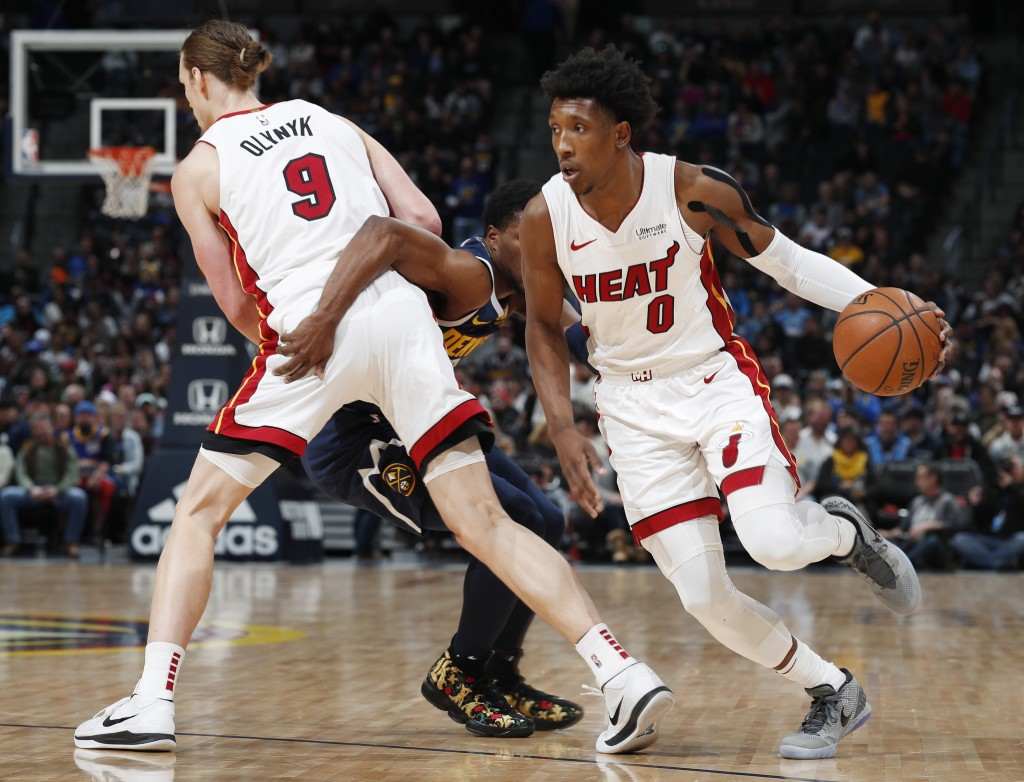 From left, Miami Heat forward Kelly Olynyk sets a pick on Denver Nuggets guard Malik Beasley and allows Miami guard Josh Richardson to drive to the ne