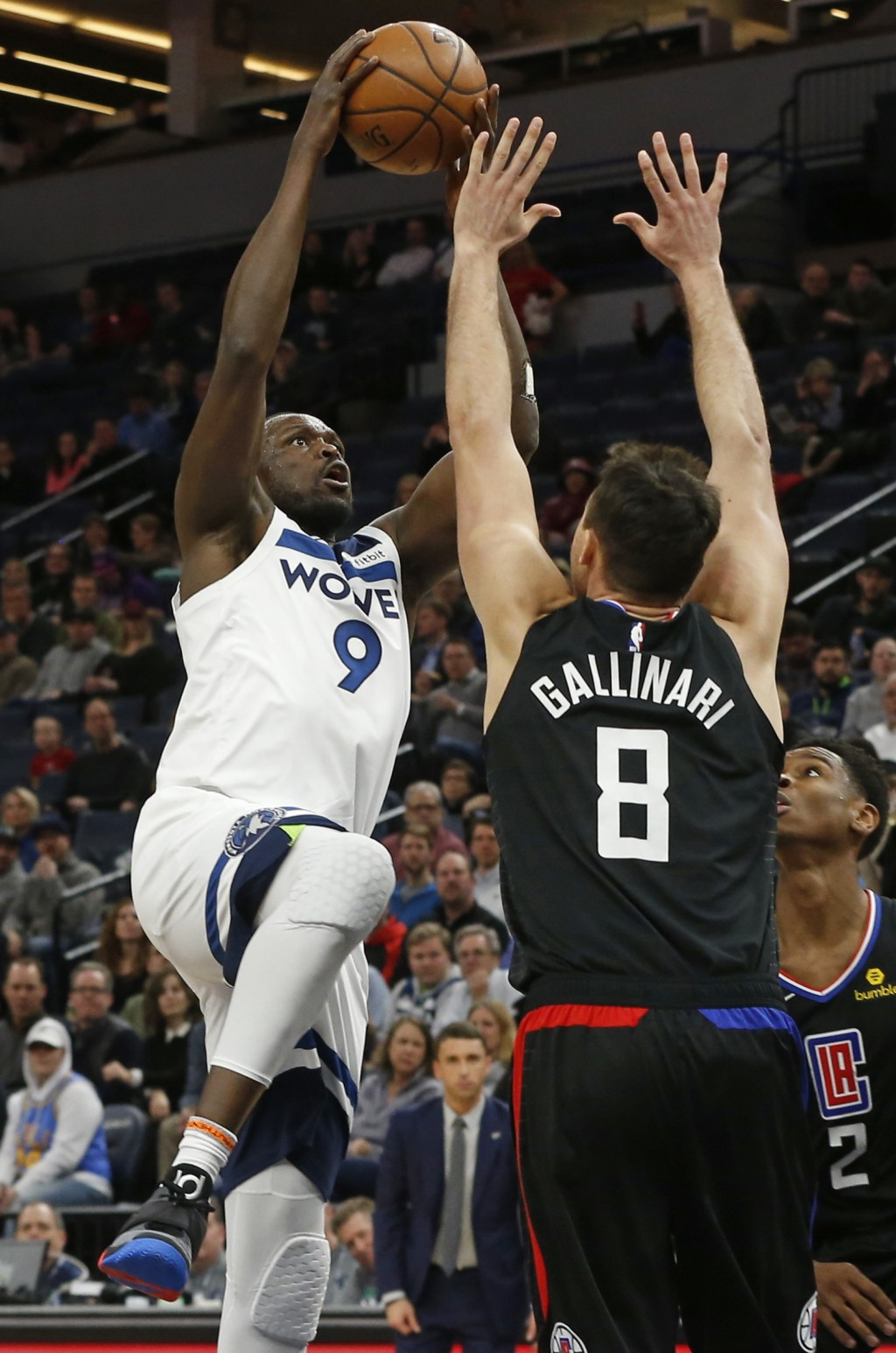 Minnesota Timberwolves' Luol Deng, left, lays up over Los Angeles Clippers' Danilo Gallinari in the first half of an NBA basketball game Monday, Feb. ...