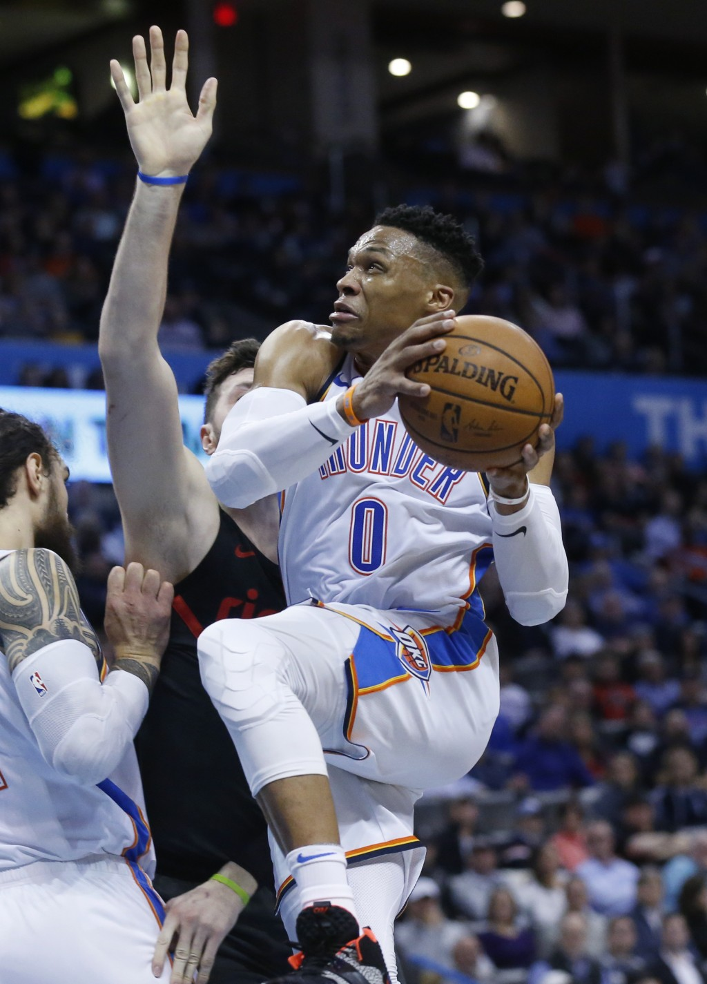 Oklahoma City Thunder guard Russell Westbrook, right, goes to the basket past Portland Trail Blazers center Jusuf Nurkic, center, in the first half of...