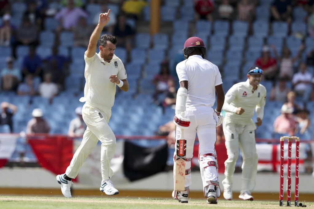 England's James Anderson celebrates taking the wicket of West Indies' captain Kraigg Brathwaite during day four of the third cricket Test match at the...
