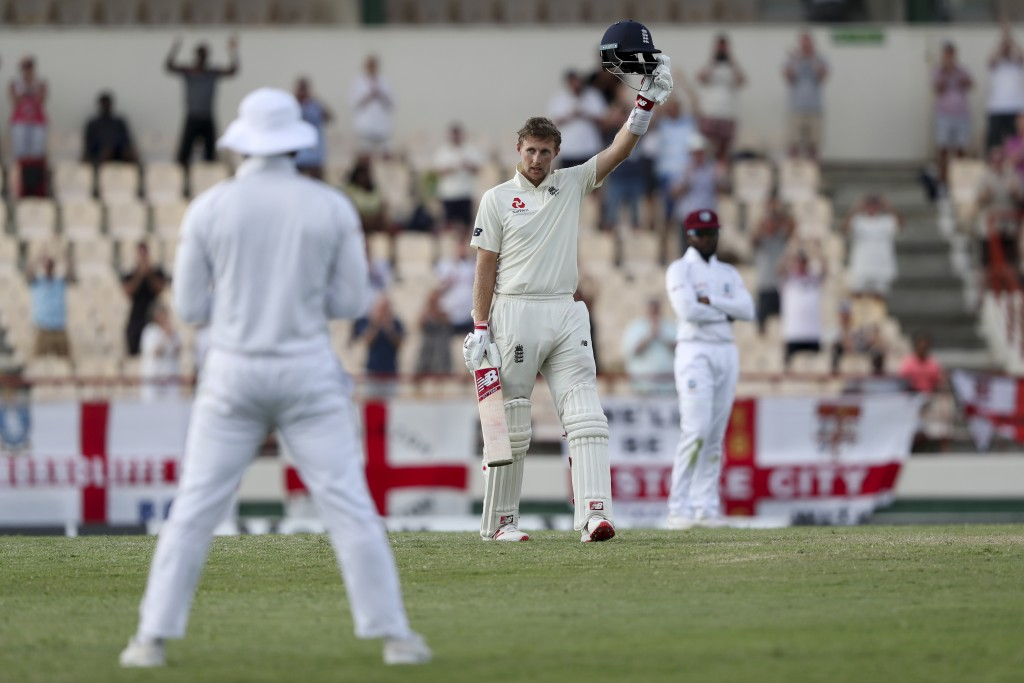 England's captain Joe Root celebrates scoring a century against West Indies during day three of the third cricket Test match at the Daren Sammy Cricke...