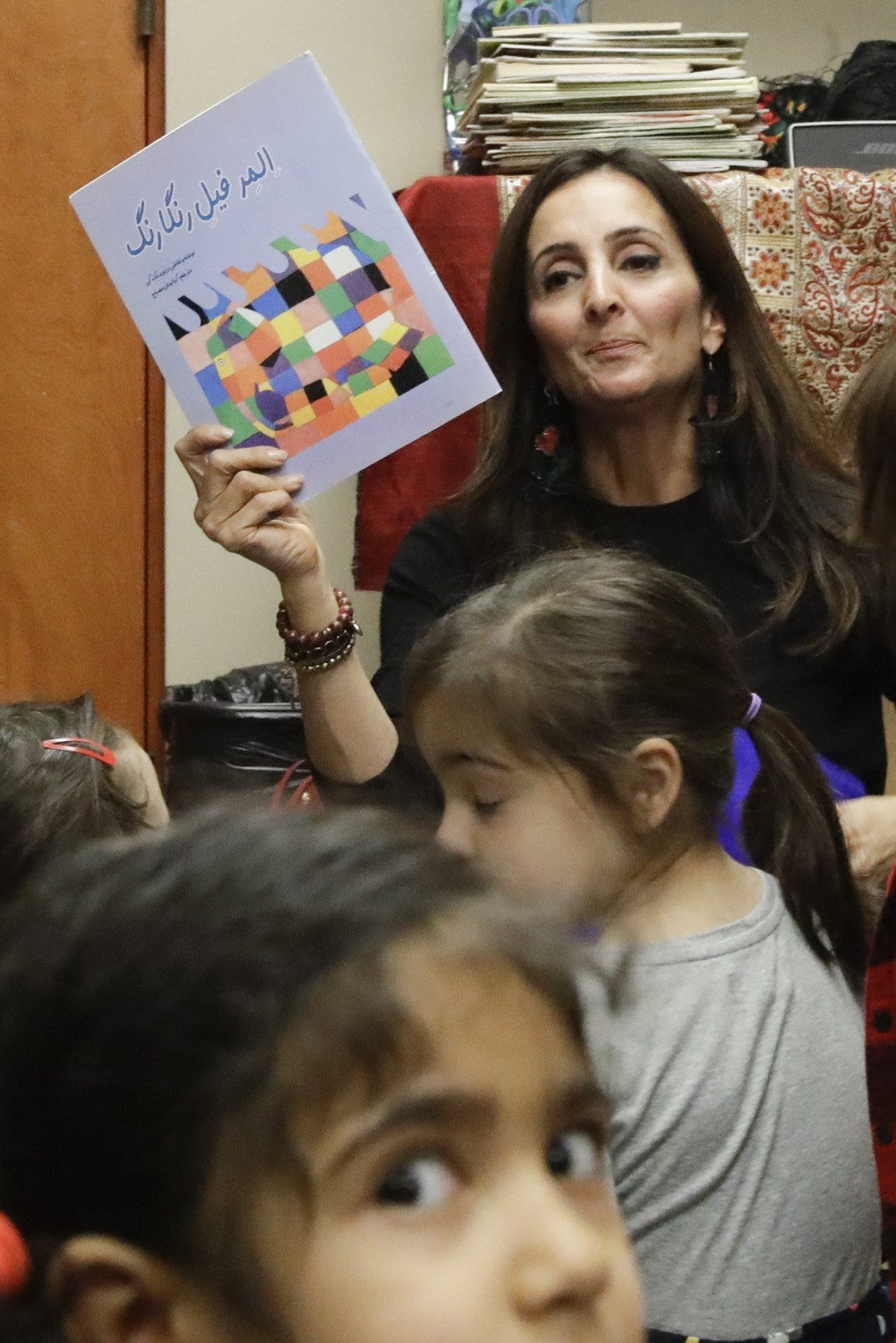 In this Jan. 23, 2019, photo, Bahareh Hedyahe leads Persian story time at Irvine public library in Irvine, Calif. It's been four decades since the Ira