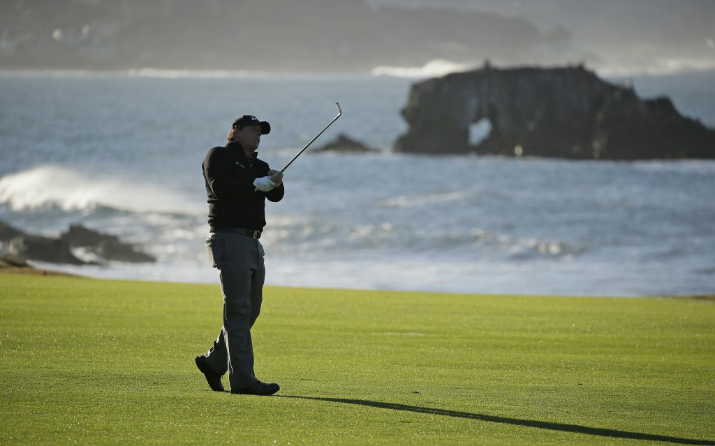 Phil Mickelson hits from the 18th fairway of the Pebble Beach Golf Links during the final round of the AT&T Pebble Beach Pro-Am golf tournament Monday