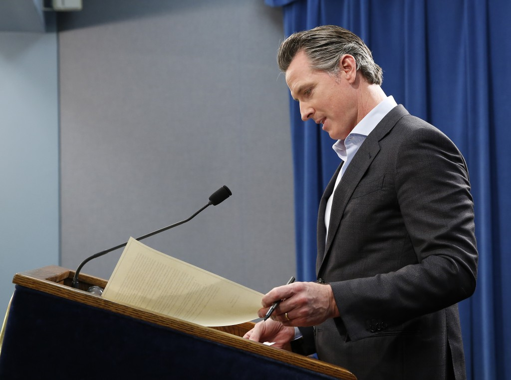 California Gov. Gavin Newsom prepares to sign an executive order to withdraw most of the National Guard troops from the nation's southern border and c