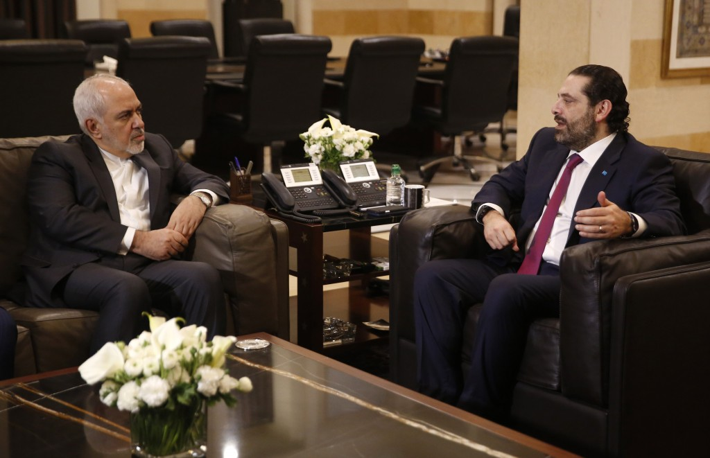 Lebanese Prime Minister Saad Hariri, right, meets with Iran's Foreign Minister Mohammad Javad Zarif, at the government palace, in Beirut, Lebanon, Mon...