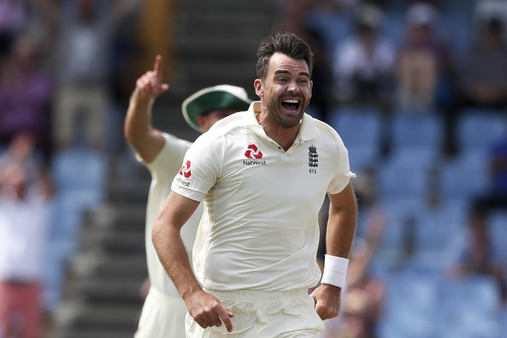 England's James Anderson celebrates taking the wicket of West Indies' John Campbell during day four of the third cricket Test match at the Daren Sammy...