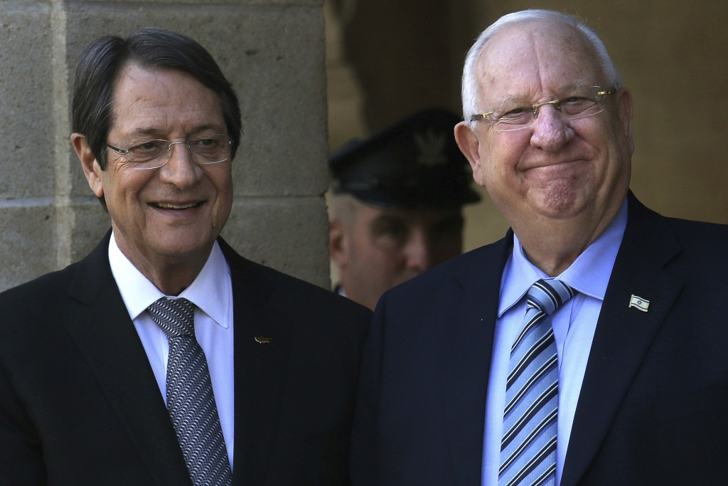 Cyprus' president Nicos Anastasiades, left, and Israel's President Reuven Rivlin smile at the presidential palace in divided capital Nicosia, Cyprus, ...