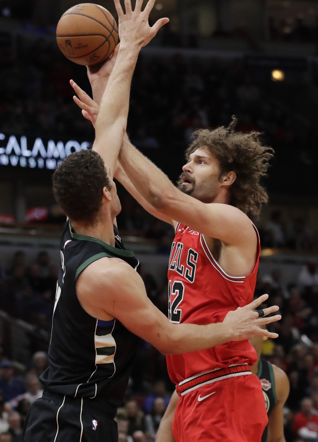 Chicago Bulls center Robin Lopez, right, shoots against Milwaukee Bucks center Brook Lopez during the first half of an NBA basketball game Monday, Feb...