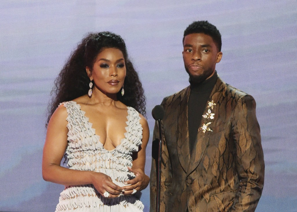 FILE - In this Jan. 27, 2019, file photo, Angela Bassett, left, and Chadwick Boseman, nominated for outstanding performance by a cast in a motion pict