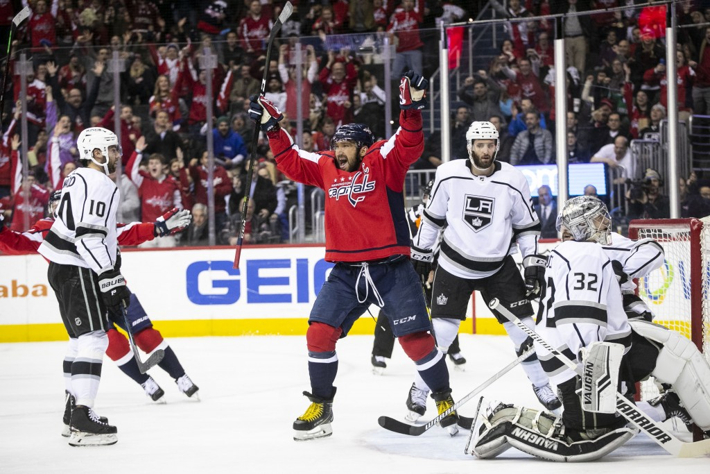 Washington Capitals left wing Alex Ovechkin (8), of Russia, celebrates after assisting a goal scored by defenseman Christian Djoos (29), of Sweden, du...