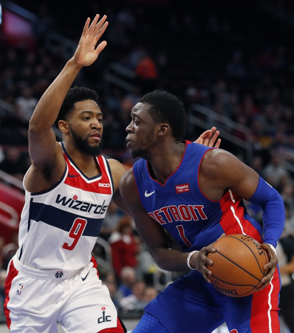 Detroit Pistons guard Reggie Jackson (1) is defended by Washington Wizards guard Chasson Randle (9) during the first half of an NBA basketball game, M