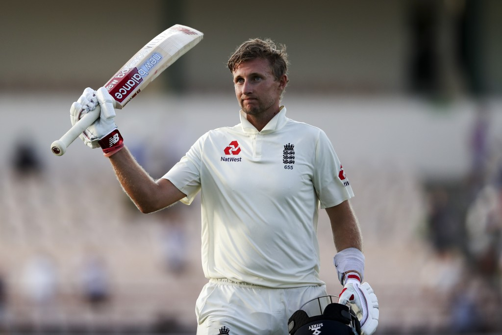England's captain Joe Root raises his bat as he leaves the field after day three of the third cricket Test match against West Indies at the Daren Samm...