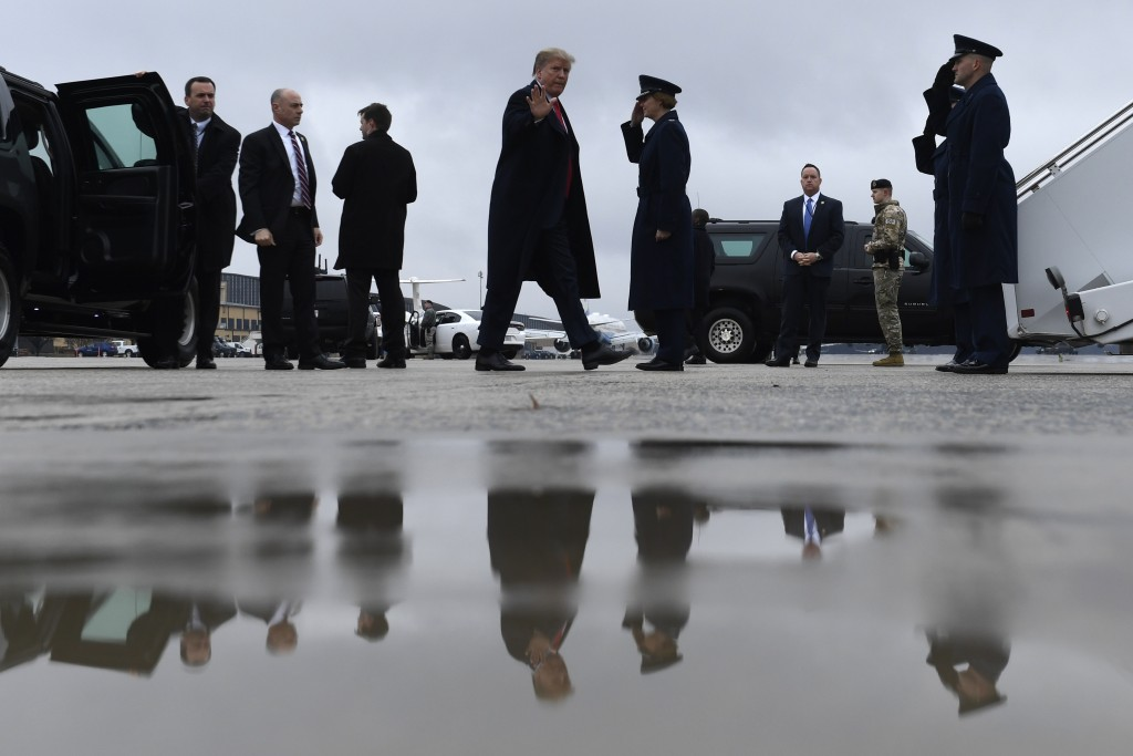 President Donald Trump waves as he arrives to board Air Force One at Andrews Air Force Base in Md., Monday, Feb. 11, 2019. Trump is heading to El Paso...