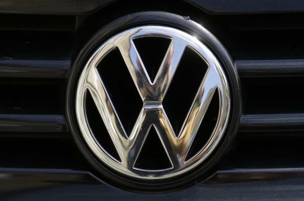 FILE - In this Aug. 1, 2017 file photo the car marques badge of Volkswagen, VW, is photographed on a car in Berlin, Germany.  Economists at the Halle ...
