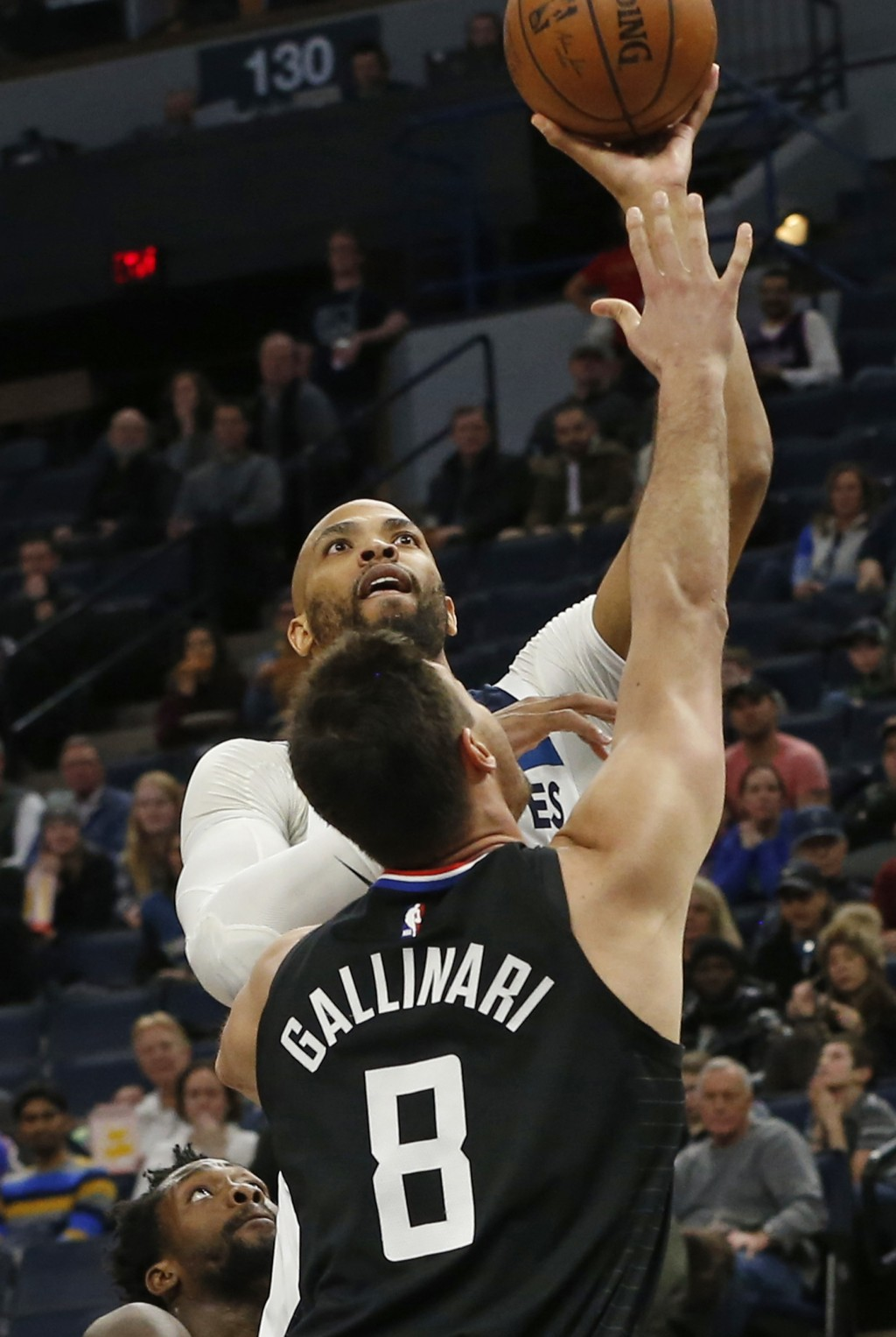 Minnesota Timberwolves' Taj Gibson, top, lays up over Los Angeles Clippers' Danilo Gallinari in the first half of an NBA basketball game Monday, Feb. ...