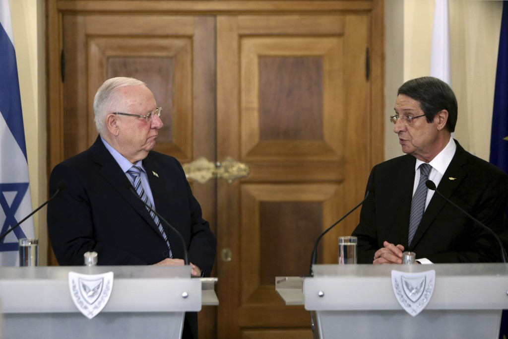 Cyprus' president Nicos Anastasiades, right, and Israel's President Reuven Rivlin talk, during a press conference after their meeting at the president