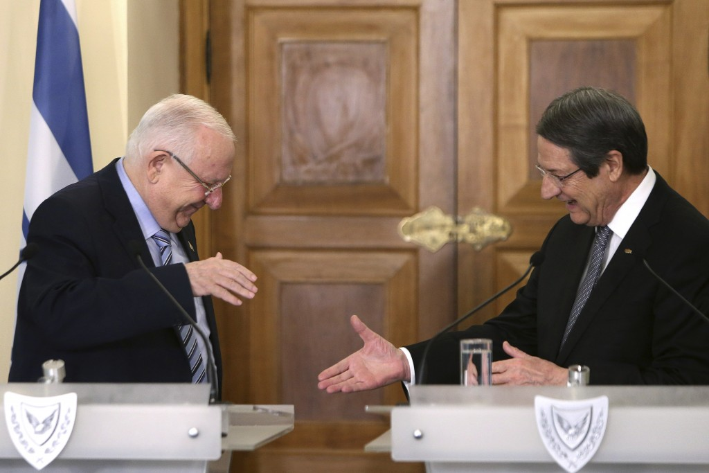 Cyprus' president Nicos Anastasiades, right, shakes hands with Israel's President Reuven Rivlin after their meeting at the presidential palace in divi...