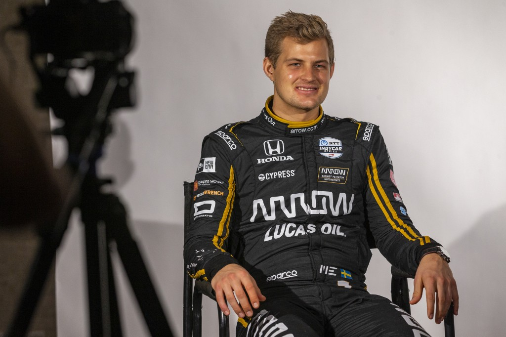 IndyCar driver Marcus Ericsson, of Sweden, is interviewed during IndyCar auto racing media day, Monday, Feb. 11, 2019, in Austin, Texas. (AP Photo/Ste