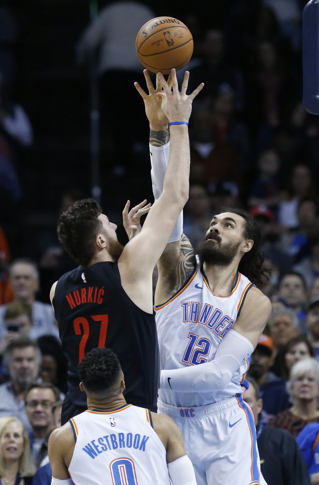 Portland Trail Blazers center Jusuf Nurkic (27) shoots as Oklahoma City Thunder center Steven Adams (12) defends in the first half of an NBA basketbal