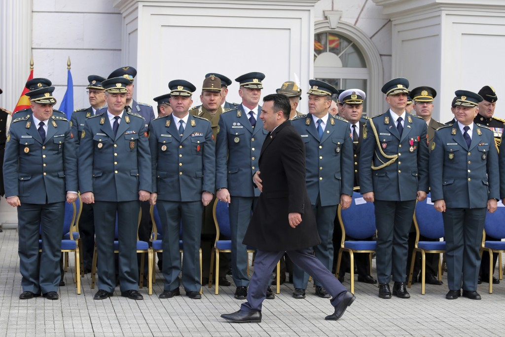 Macedonian Prime Minister Zoran Zaev passes in front of army officers during a ceremony at the government building in Skopje, Tuesday, Feb. 12, 2019. ...