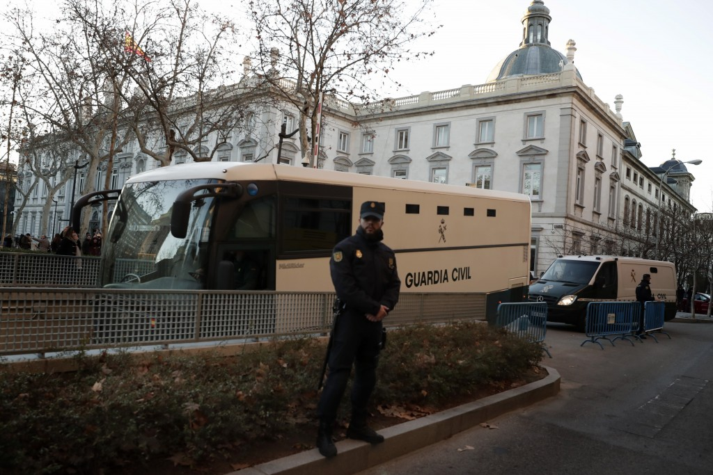 A bus belonging to Spain's Civil Guard allegedly carrying Catalonian politicians and activists, arrives at the Spanish Supreme Court in Madrid, Tuesda...