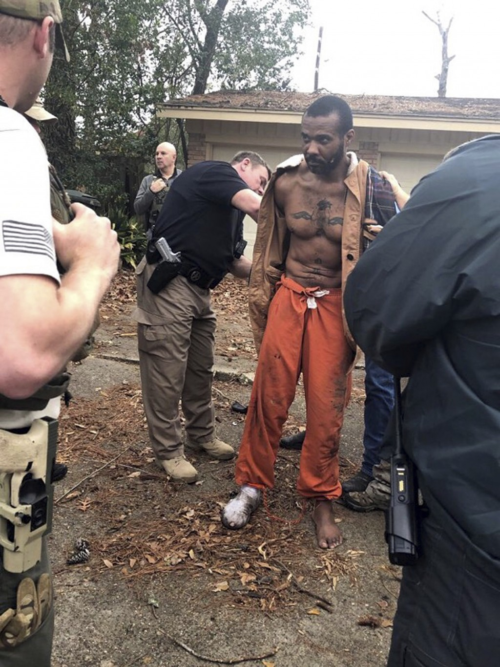 FILE - This Feb. 3, 2019 photo released by the Conroe Police Department shows Cedric Marks being captured after nine-hour manhunt that began when he e...