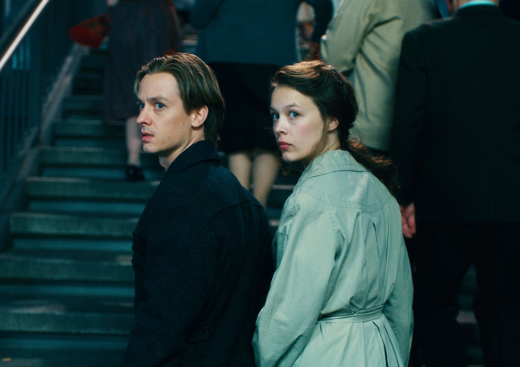 """This image released by Sony Pictures Classics shows Tom Schilling, left, and Paula Beer in a scene from """"Never Look Away.""""  (Caleb Deschanel/Sony Pict..."""